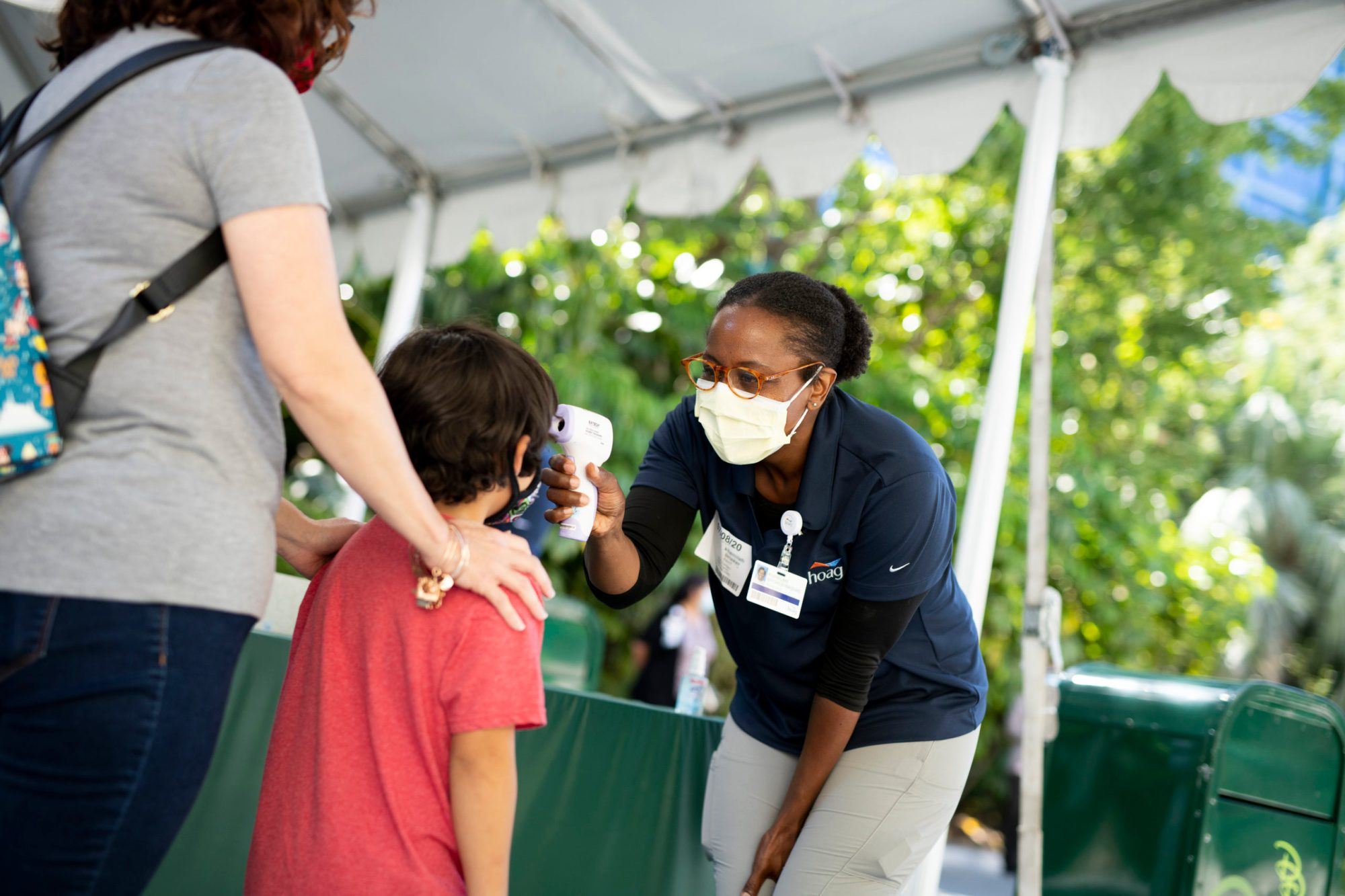 A child has his temperature taken in Downtown Disney on July 9, 2020, in Anaheim, Orange County. (Derek Lee/Disneyland Resort via Getty Images)