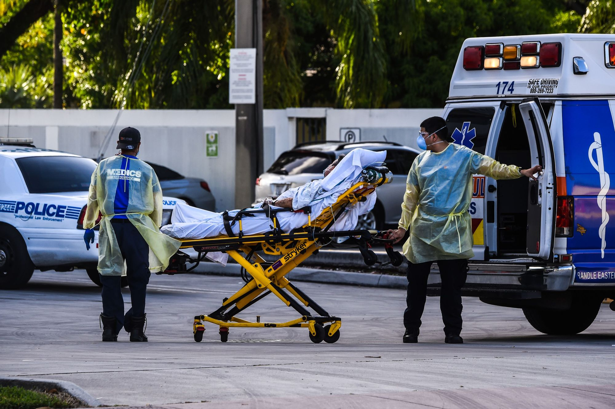 Medics transfer a patient on a stretcher from an ambulance outside of Emergency at Coral Gables Hospital where Coronavirus patients are treated in Coral Gables near Miami, on July 30, 2020. Florida has emerged as a major new epicenter of the U.S. battle against the disease, with confirmed cases recently surpassing New York and now second only to California. (CHANDAN KHANNA/AFP via Getty Images)