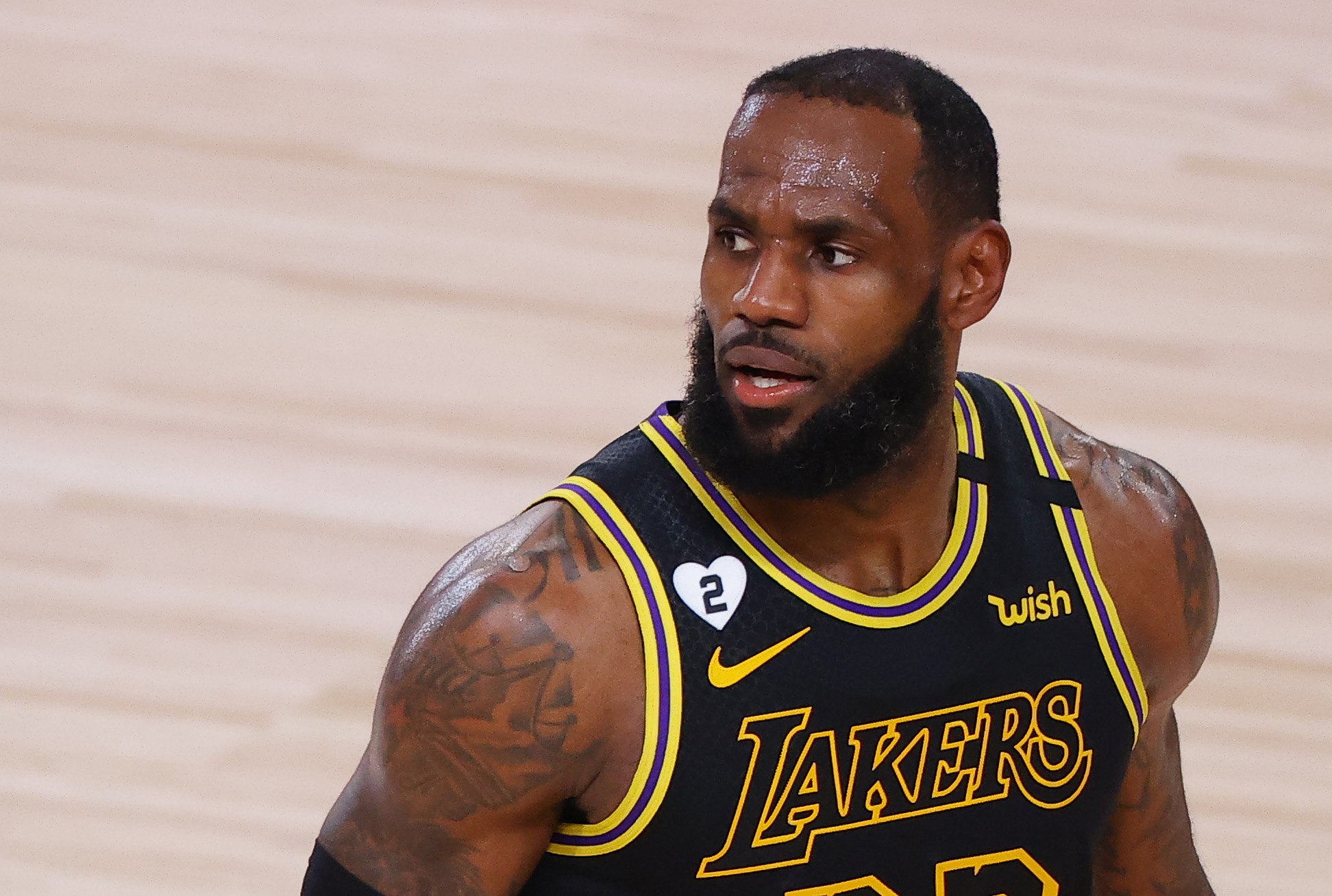LeBron James of the Los Angeles Lakers reacts against the Portland Trail Blazers during the third quarter in Game Four of the Western Conference First Round during the 2020 NBA Playoffs at AdventHealth Arena at ESPN Wide World Of Sports Complex on Aug. 24, 2020 in Lake Buena Vista, Florida. (Kevin C. Cox/Getty Images)