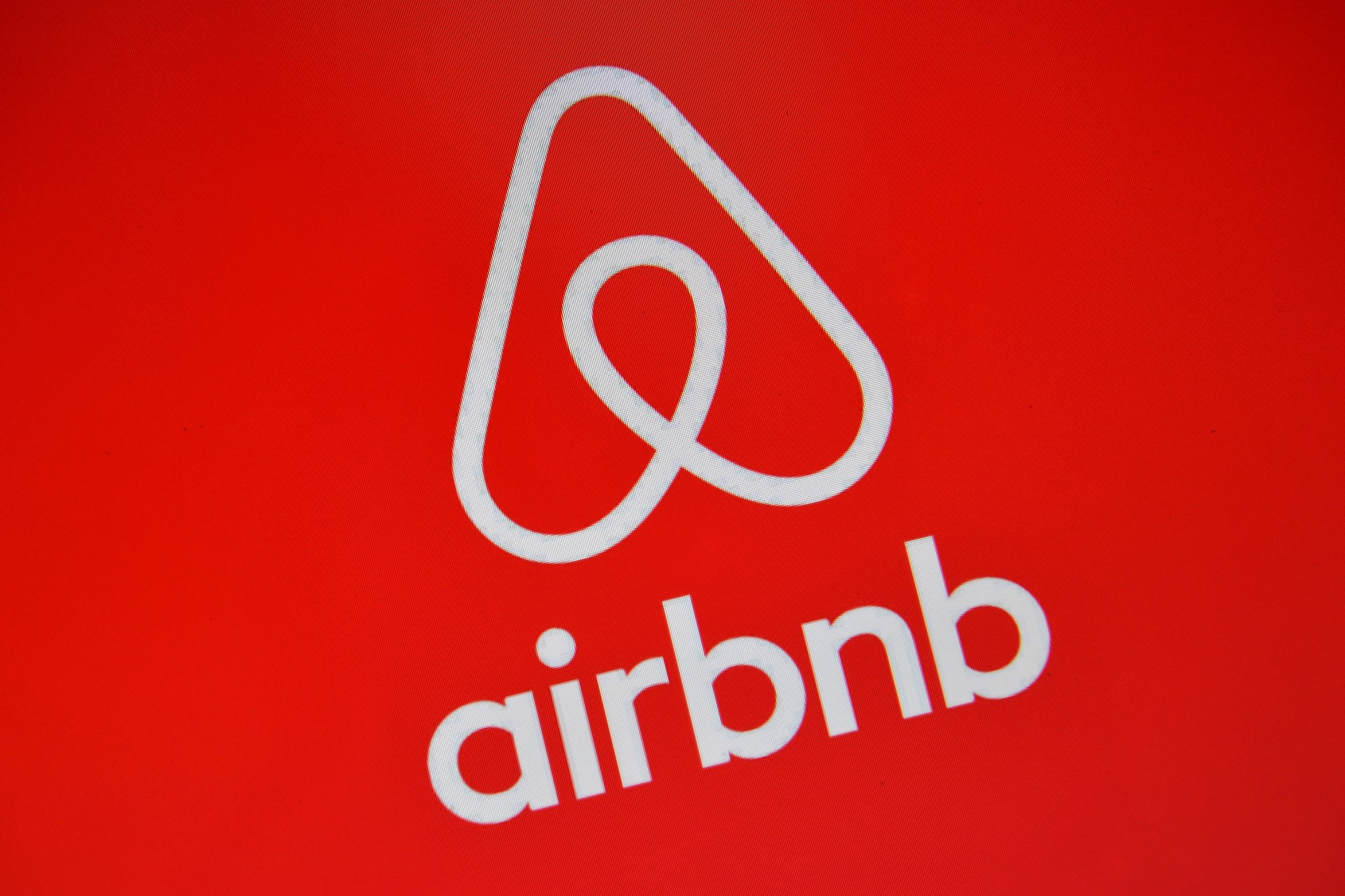 The Airbnb logo is displayed on a computer screen in London on Aug. 3, 2016. (Carl Court / Getty Images)