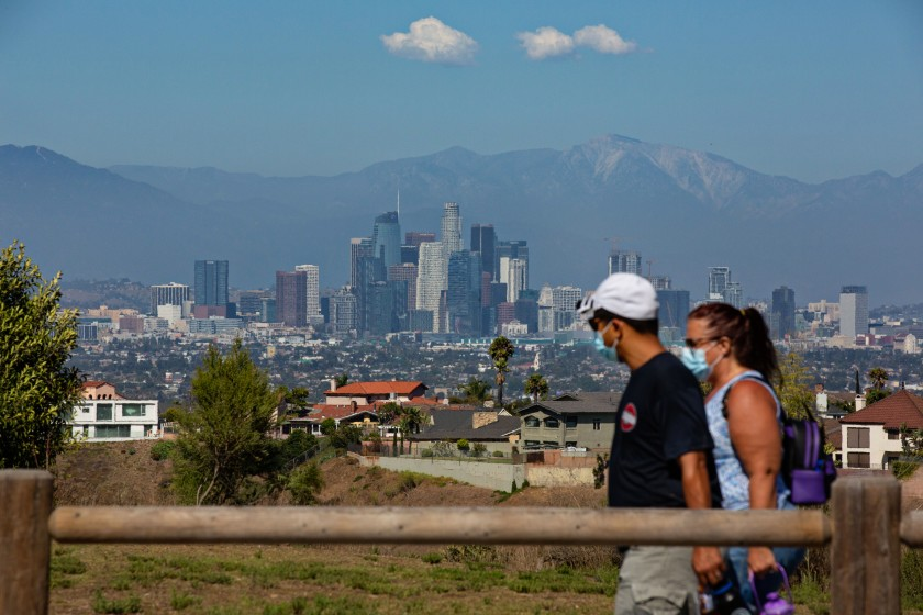 Masked hikers trek through Kenneth Hahn park in Los Angeles.(Jason Armond / Los Angeles Times)