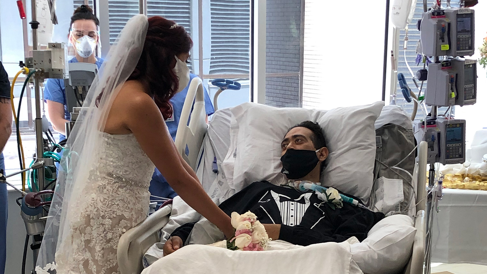 Carlos Muniz and Grace Leimann are seen at San Antonio Methodist Hospital after their wedding in the hospital. (Methodist Healthcare via CNN)