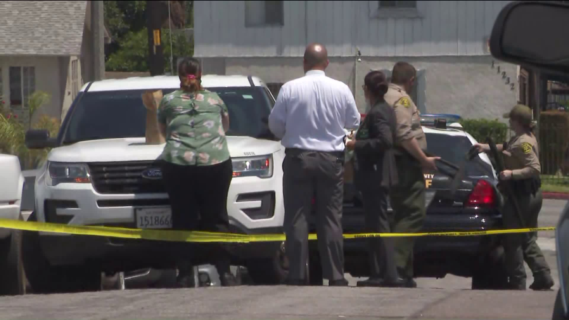 Deputies investigate at the scene of a fatal shooting in the Westmont area of South L.A. on Aug. 4, 2020. (KTLA)