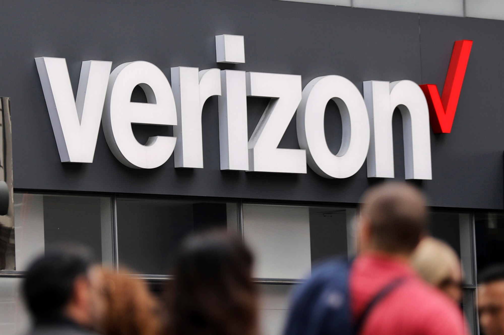 In this May 2, 2017, file photo, Verizon corporate signage is displayed on a store in Manhattan's Midtown area in New York.(AP Photo/Bebeto Matthews, File)