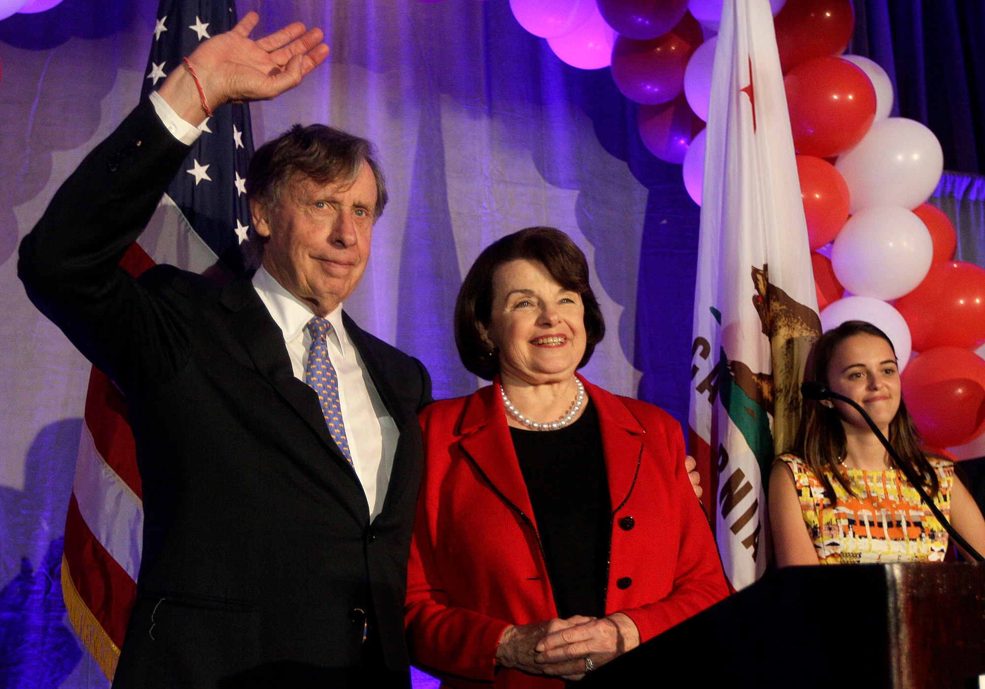 U.S. Sen. Dianne Feinstein, center, smiles as she stands on stage with husband Richard Blum before speaking at an election night rally in San Francisco on Nov. 6, 2012. (AP Photo/Jeff Chiu)