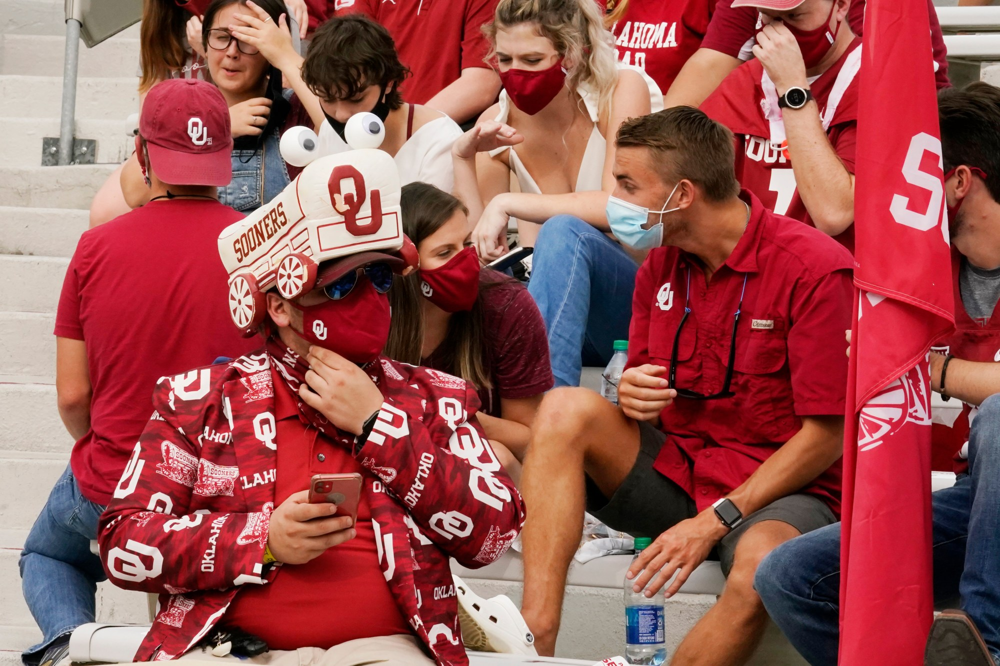Fans in the student section wait for the start of the Missouri State vs. Oklahoma NCAA college football game on Sept. 12, 2020 in Norman, Okla. Due to coronavirus (COVID-19) restriction, no fans are allowed in the first rows, only cut-outs. (Sue Ogrocki-Pool/Getty Images)