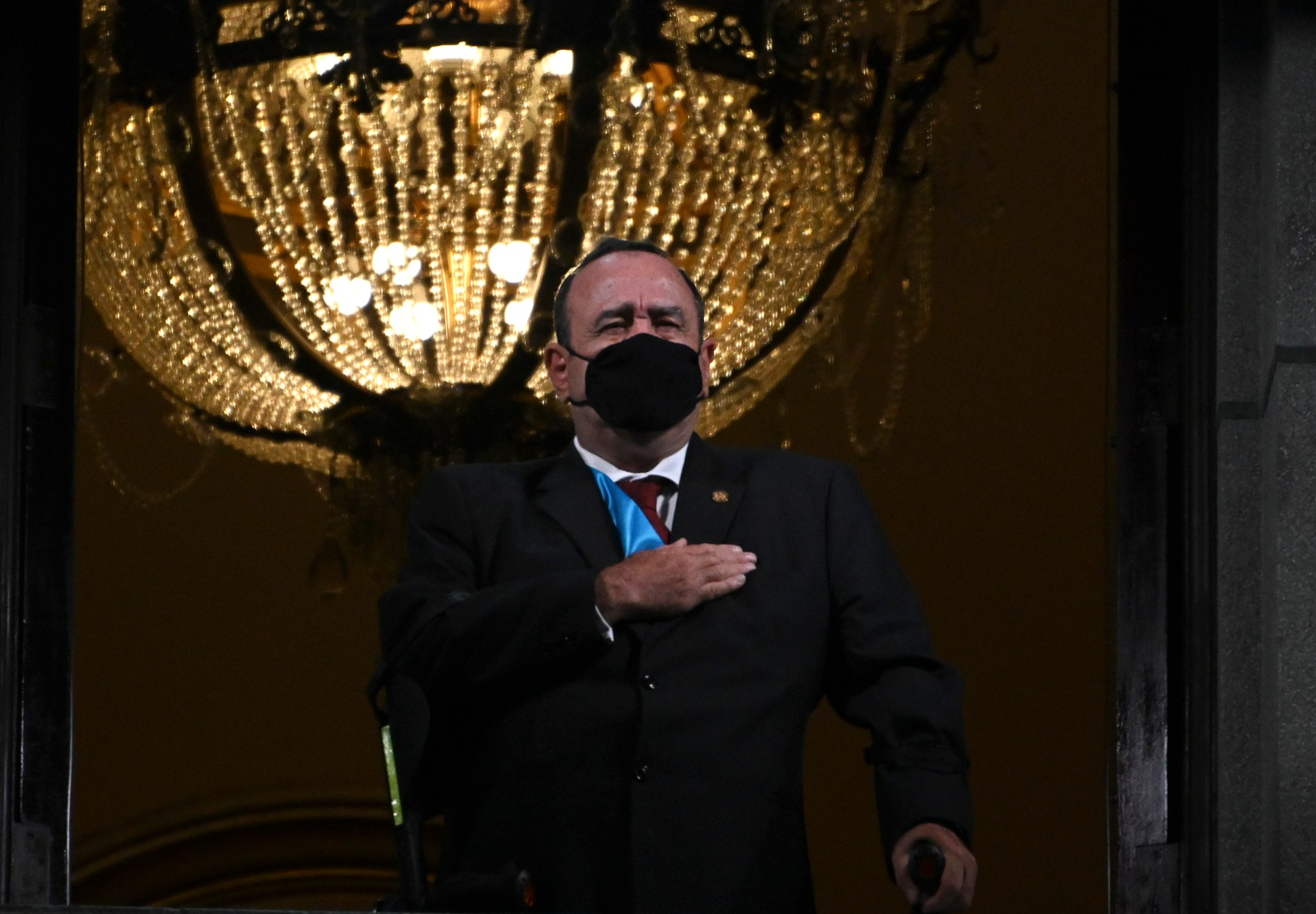 Guatemalan President Alejandro Giammattei wearing a face mask, sings the national anthem during the celebrations for the 199th anniversary of the Guatemalan independence in Guatemala City on Sept. 14, 2020. (Johan ORDONEZ/AFP via Getty Images)