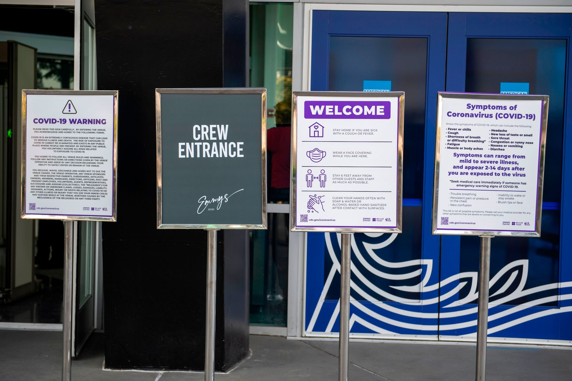A sign showing the rules for the Emmys' crew is posted in front of the Staples center, at LA Live, where part of the Emmy will take place, Sept. 18, 2020, in Los Angeles California. (VALERIE MACON/AFP via Getty Images)