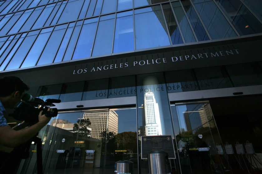 A man holds a camera outside the Los Angeles Police Department headquarters in this undated photo. (Bob Chamberlin / Los Angeles Times)