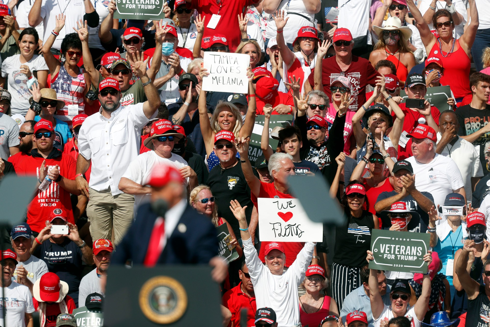 Supporters of President Donald Trump cheer him on while he gives a campaign speech just four days before Election Day outside of Raymond James Stadium on Oct. 29, 2020 in Tampa, Florida. (Octavio Jones/Getty Images)