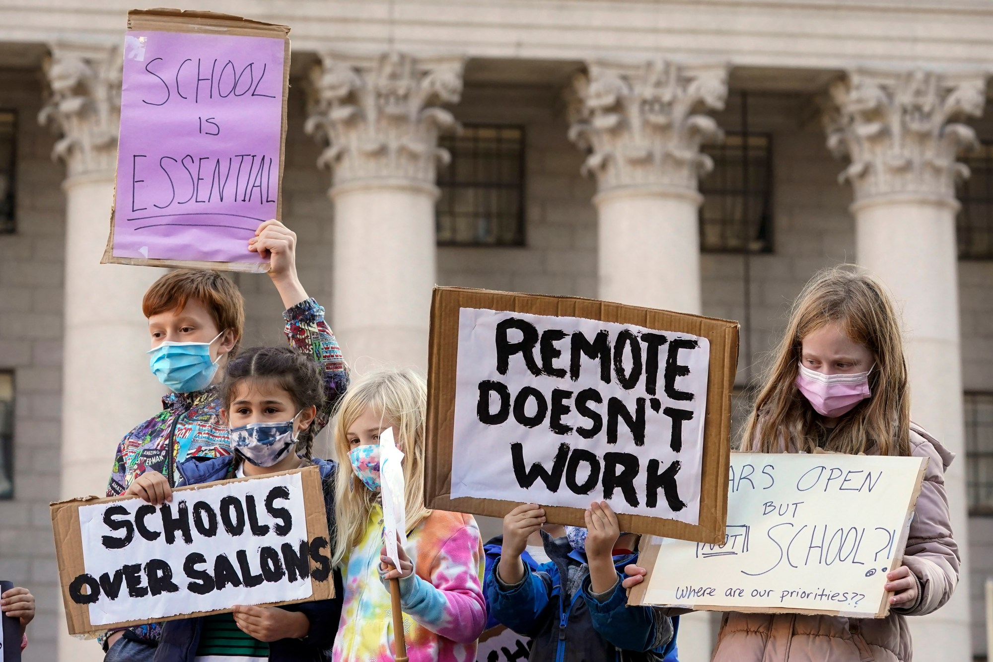 In this Nov. 14, 2020, photo, students demonstrate during a rally to call on New York Mayor Bill de Blasio to keep schools open. (AP Photo/Mary Altaffer, File)