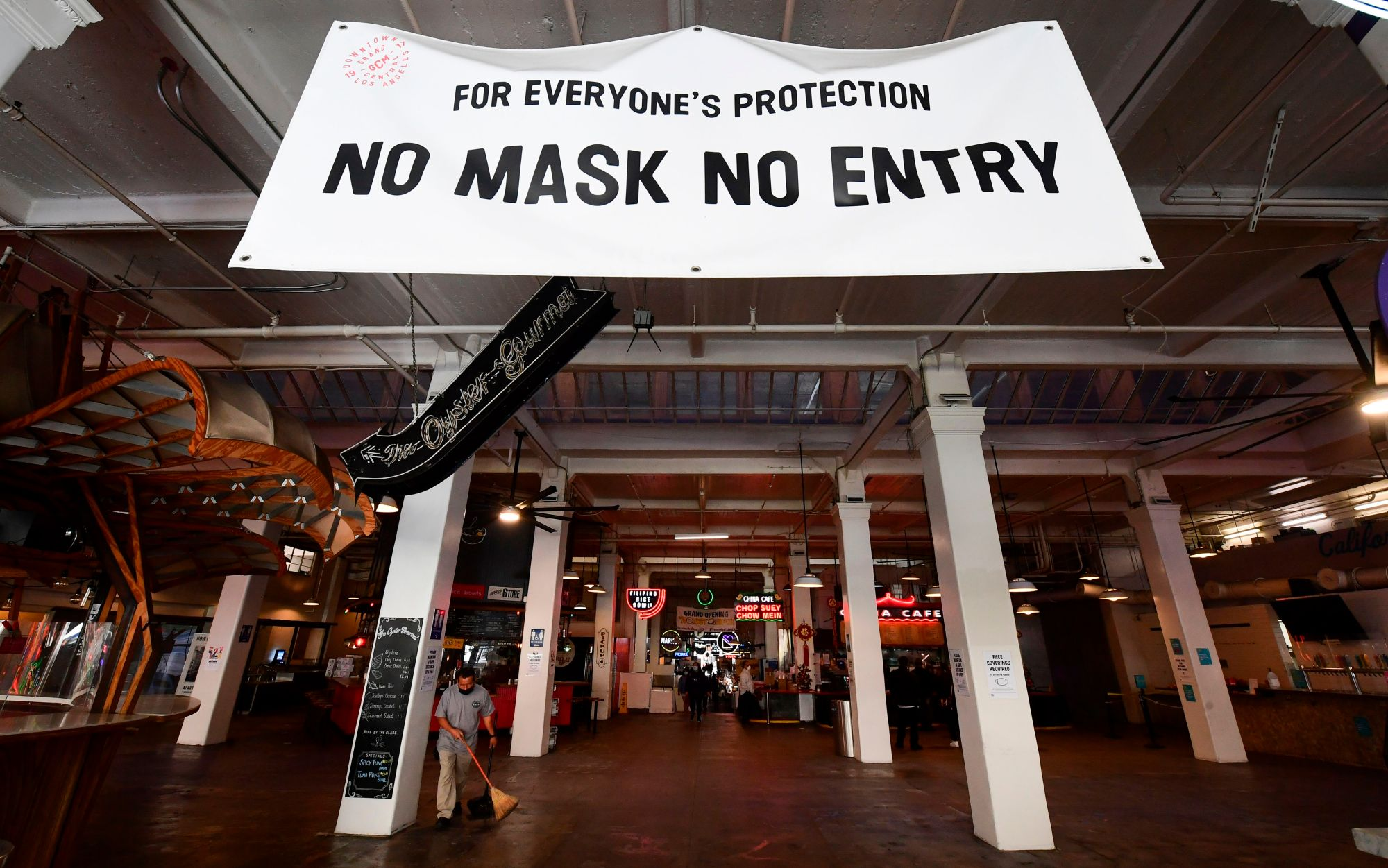 A sign reminds people to wear face masks at an empty Grand Central Market in downtown Los Angeles on Nov. 30, 2020./ (FREDERIC J. BROWN/AFP via Getty Images)