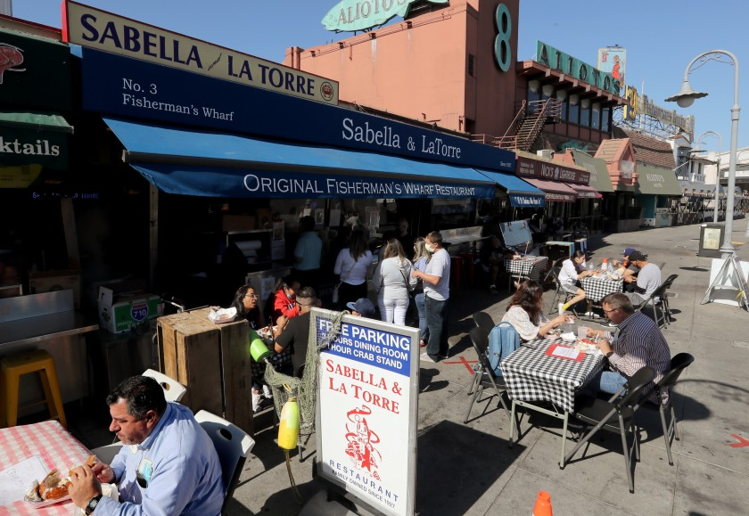 Sitting outdoors, customers dine at Fishermen's Wharf in San Francisco on Friday, Aug. 23, 2020. (Luis Sinco/Los Angeles Times)