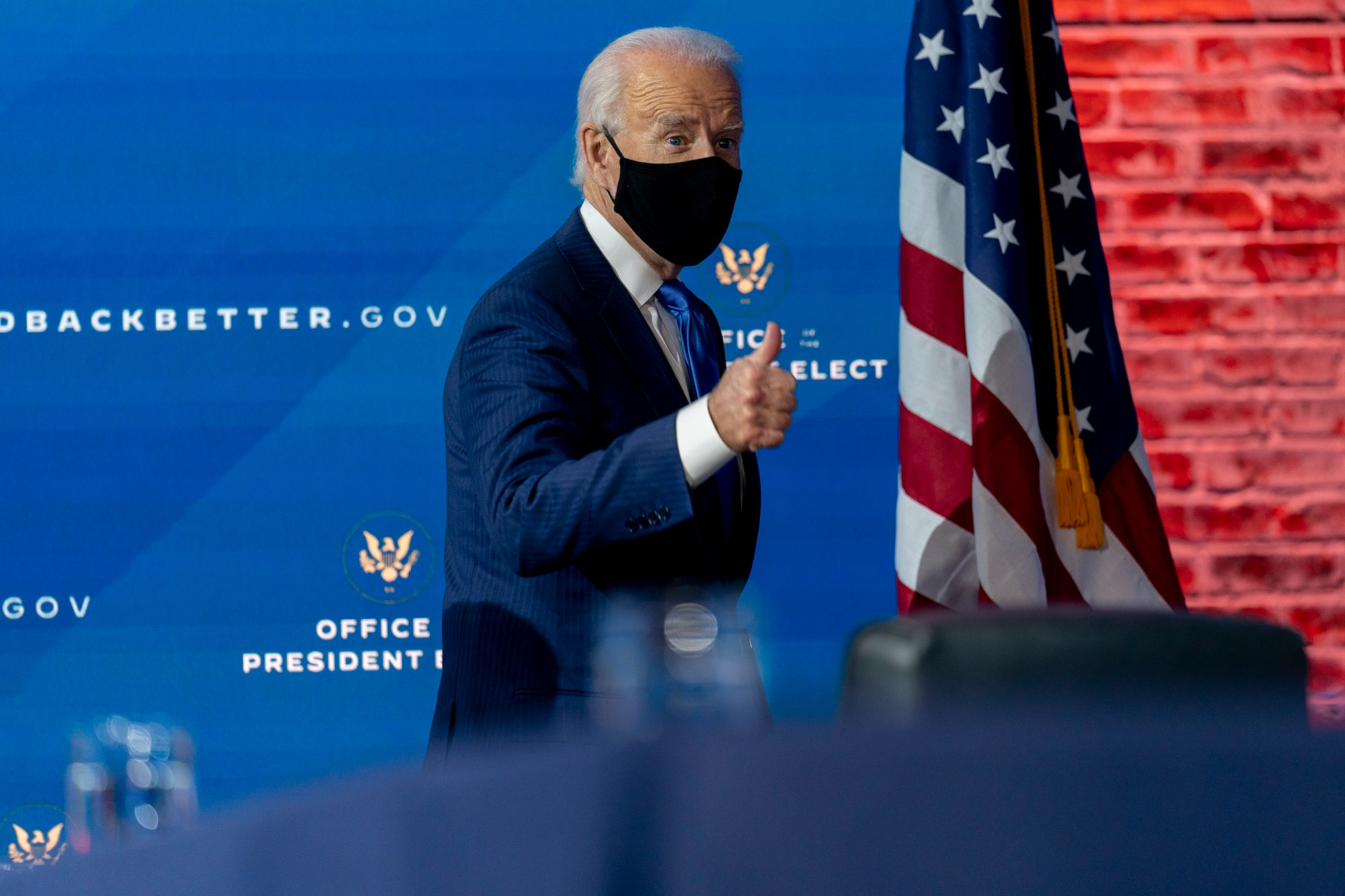 President-elect Joe Biden departs a news conference after introducing his nominees and appointees to economic policy posts at The Queen theater on Dec. 1, 2020, in Wilmington, Del. (Andrew Harnik/Associated Press)
