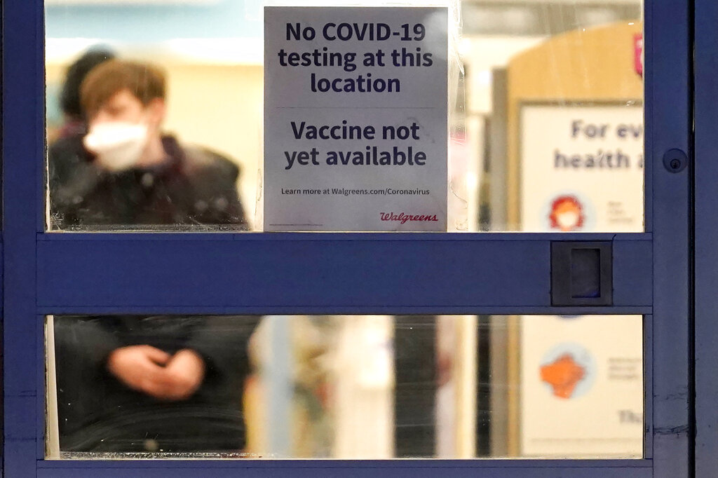 In this Jan. 16, 2021, file photo, a sign saying that a COVID-19 vaccine is not yet available hangs at Walgreens in Glenview, Ill. (AP Photo/Nam Y. Huh, File)
