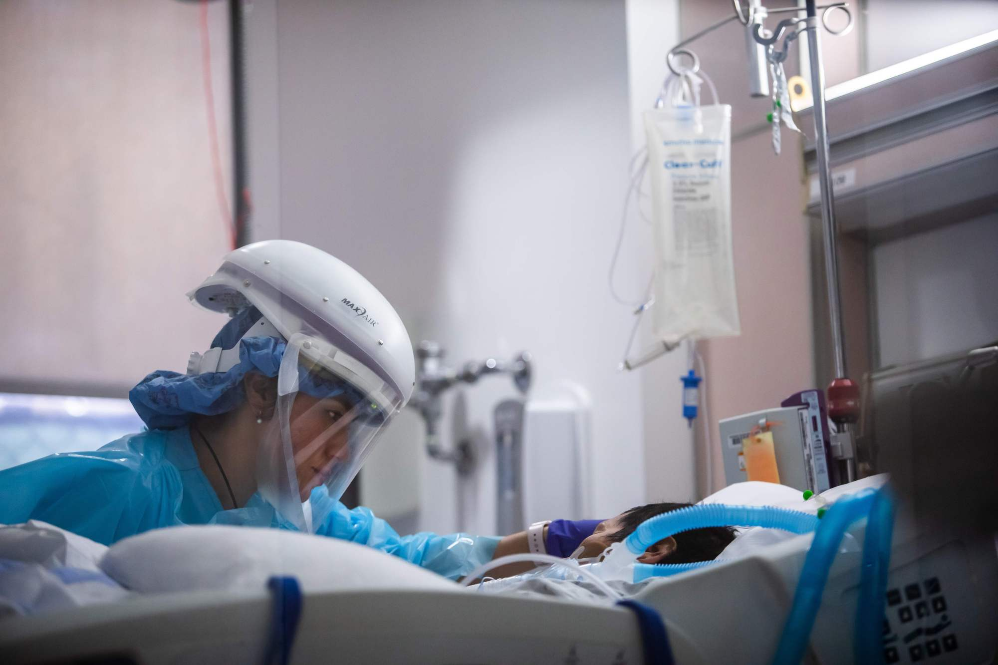 Registered nurse Yeni Sandoval wears personal protective equipment while she cares for a COVID-19 patient in the intensive care unit at Providence Cedars-Sinai Tarzana Medical Center in Tarzana on Jan. 3, 2021. (Apu Gomes / AFP / Getty Images)