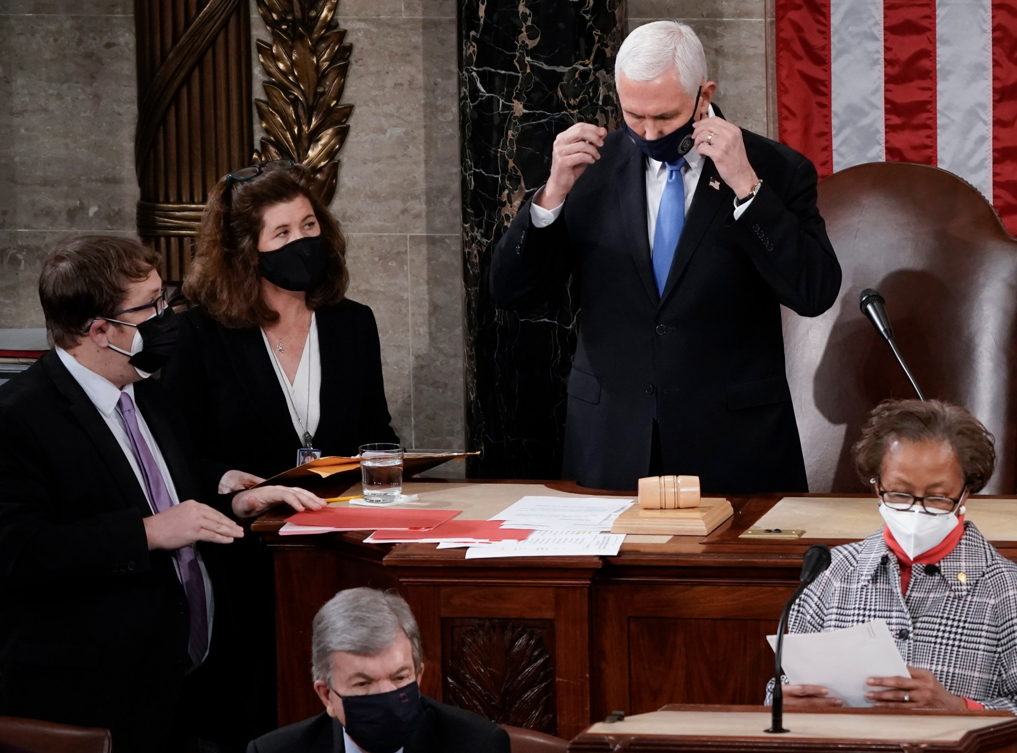 In this Jan. 6, 2021, photo, Senate Parliamentarian Elizabeth MacDonough, left, works beside Vice President Mike Pence during the certification of Electoral College ballots in the presidential election, in the House chamber at the Capitol in Washington. (AP Photo/J. Scott Applewhite)