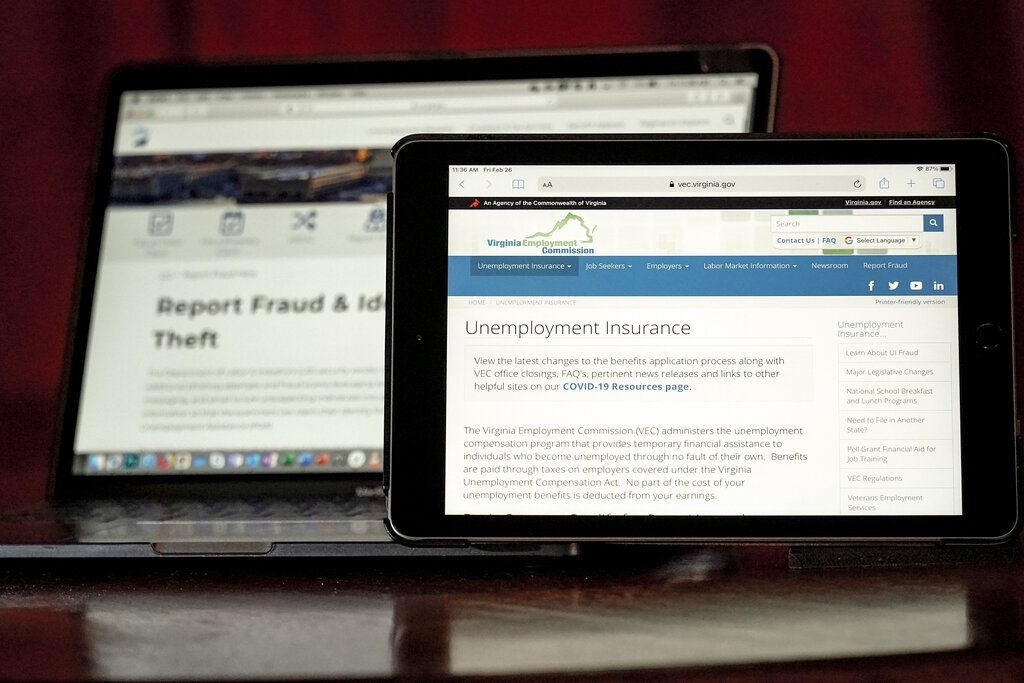 Web pages used to show information for collecting unemployment insurance in Virginia, right, and reporting fraud and identity theft in Pennsylvania, are displayed on the respective state web pages, Friday, Feb. 26, 2021, in Zelienople, Pa. (AP Photo/Keith Srakocic)