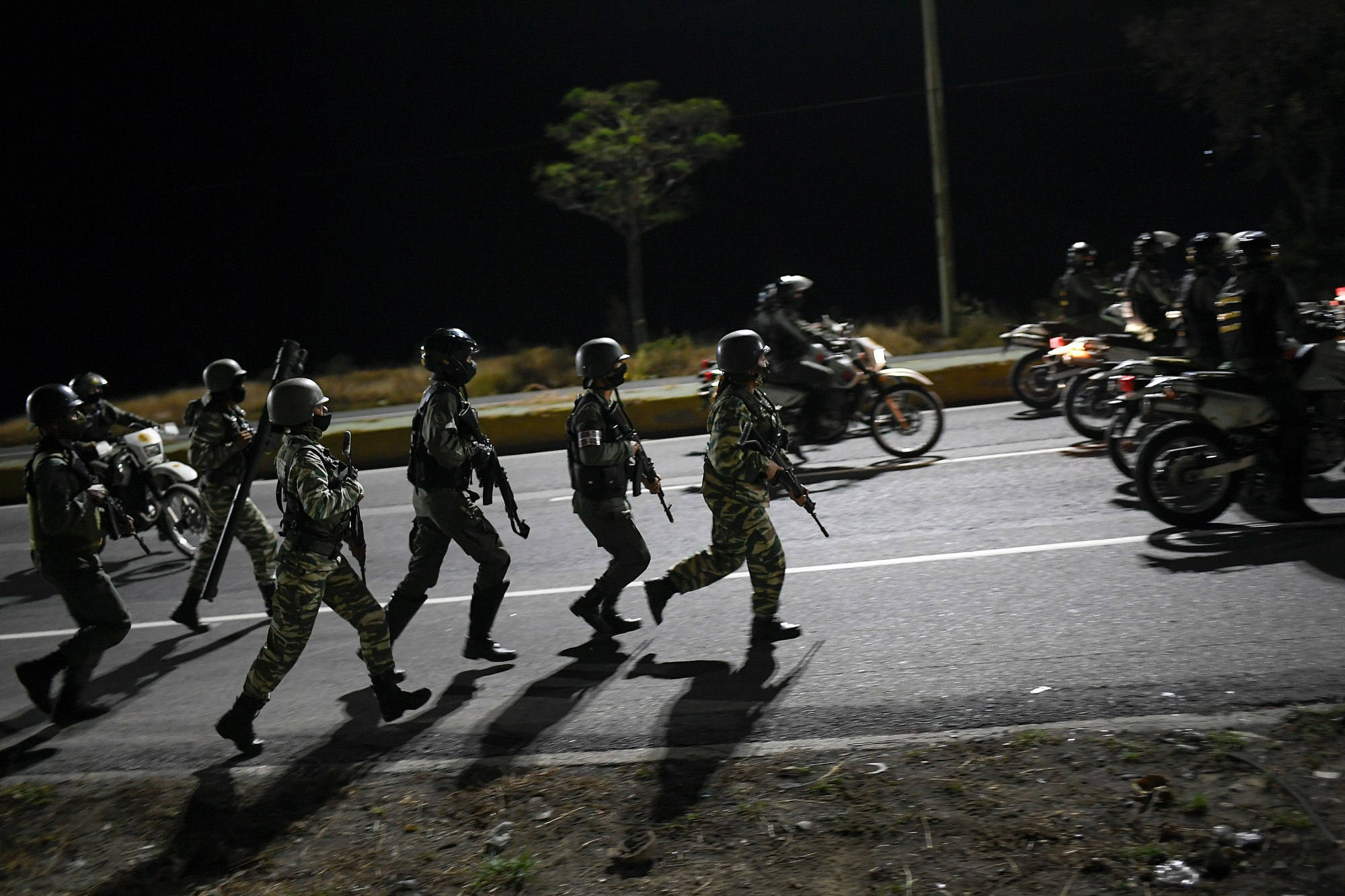 Security forces take part in a military drill to mark the eighth death anniversary of President Hugo Chavez in Caracas, Venezuela on March 5, 2021. (Matias Delacroix/Associated Press)