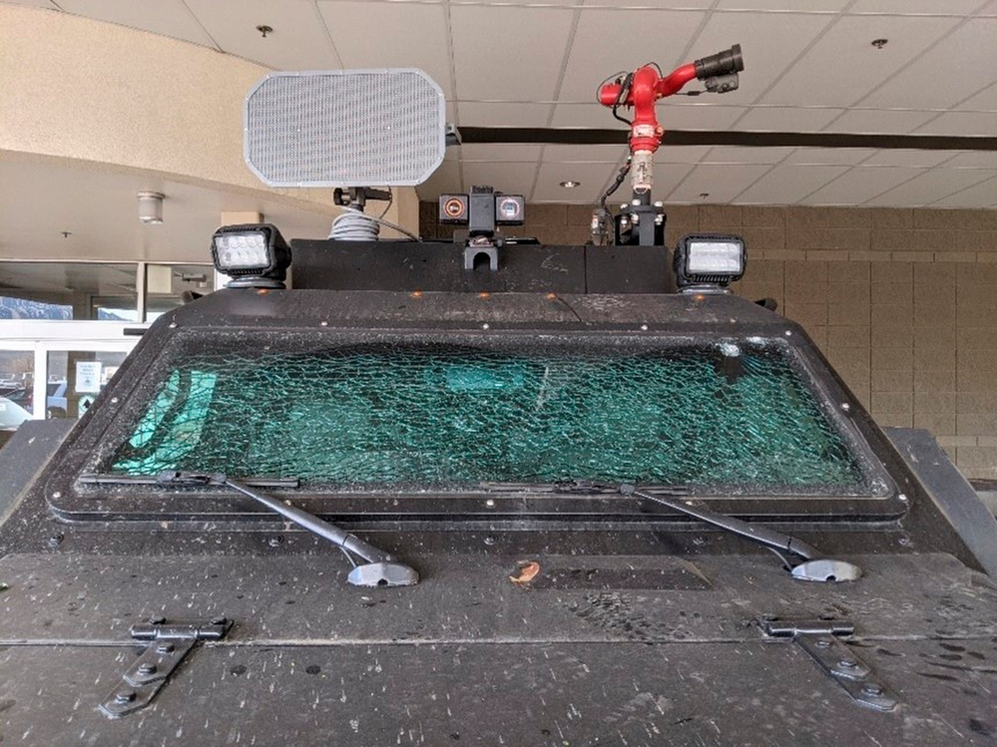 This Sunday, March 7, 2021, photo released by the City of Boulder shows the smashed windshield of a Terradyne light armored patrol vehicle at the Boulder Police Department in Boulder, Colo. (Boulder Police Department/ City of Boulder via AP)
