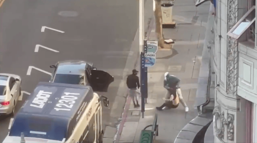Surveillance video shows a February robbery and shooting in progress in downtown Los Angeles.(Los Angeles Police Department)
