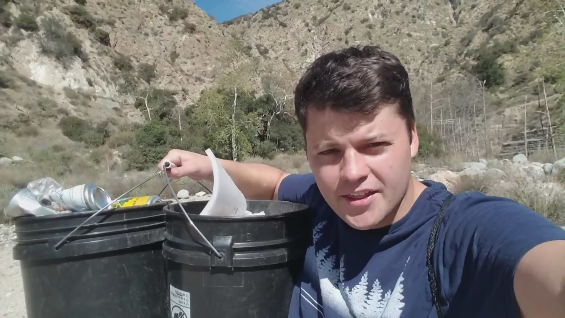 Edgar Mcgregor is seen cleaning up Eaton Canyon Park in this undated video.