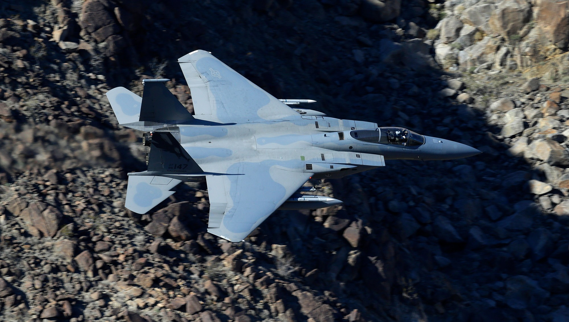 In this Feb. 28, 2017, photo, an F-15C Eagle from the California Air National Guard, 144th Fighter Wing, flies through the nicknamed Star Wars Canyon over Death Valley National Park, Calif. Sources told the L.A. Times that deploying an F-15C, an air-to-air combat jet based at the Guard's 144th Fighter Wing in Fresno, to frighten demonstrators in this country would have been an inappropriate use of the military against U.S. civilians. (AP Photo/Ben Margot)