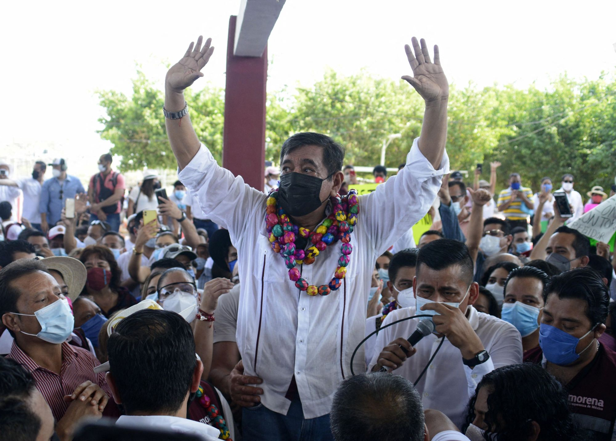 Felix Salgado Macedonio, accused of rape by several women, waves at supporters during the start of his campaign as candidate for governor of the state of Guerrero, in Acapulco, Mexico, on March 13, 2021. The ruling Morean Party announced on March 12, that Salgado was running for governor, prompting several demonstrations by feminist groups. (Francisco ROBLES / AFP via Getty Images)