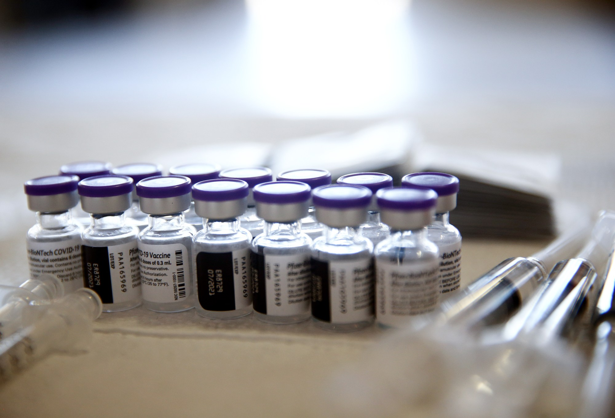 Vials containing doses of the Pfizer COVID-19 vaccine are viewed at a clinic targeting minority community members at St. Patrick's Catholic Church on April 9, 2021 in Los Angeles, California. (Photo by Mario Tama/Getty Images)