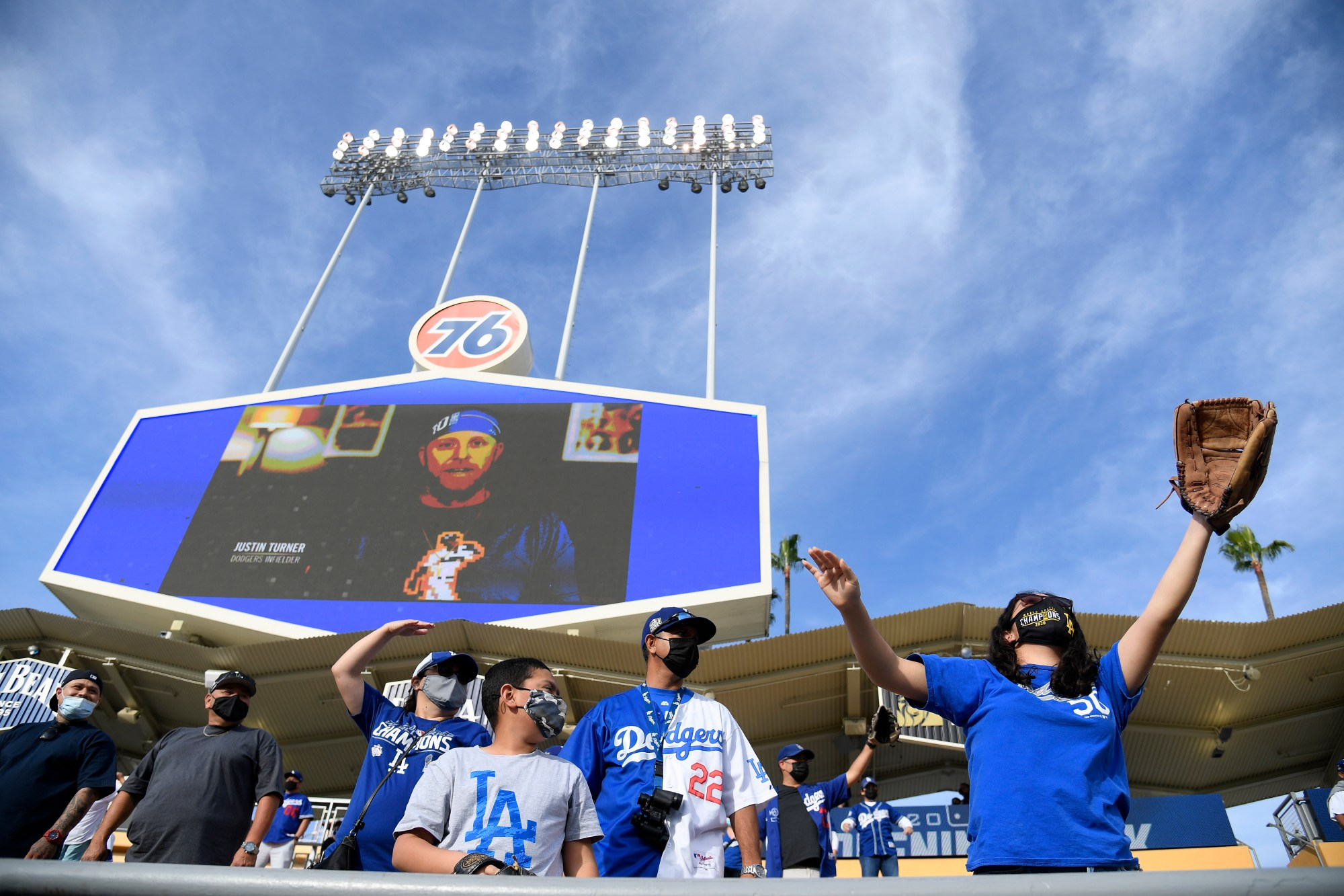 Fans watch homeruns at batting practice before the game between the Washington Nationals and Los Angeles Dodgers at Dodger Stadium on April 10, 2021 in Los Angeles, California. (Harry How/Getty Images)