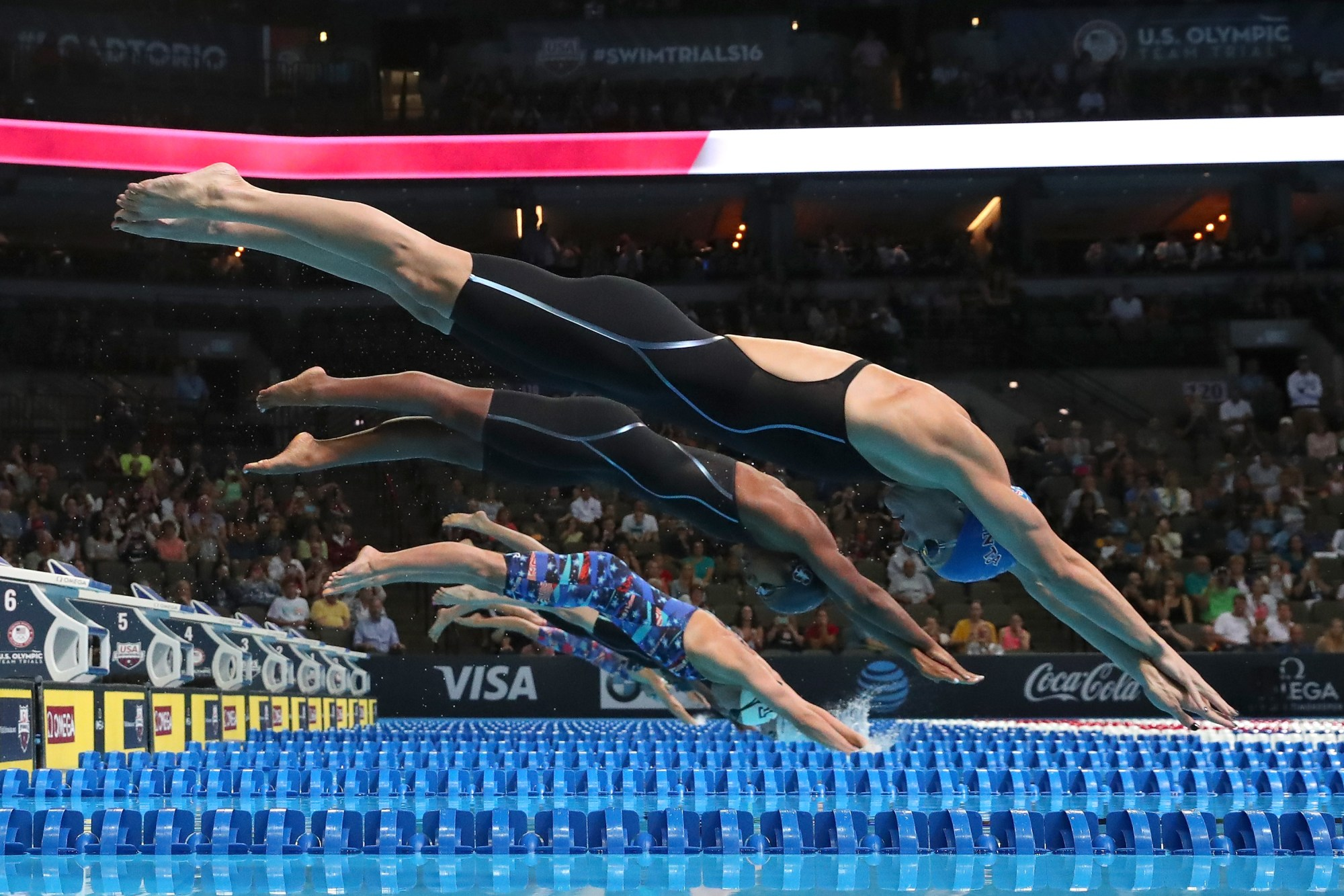 Amanda Weir, Lia Neal, Katrina Konopka, Madison Kennedy and Abbey Weitzeil of the United States dive in to compete in the final heat for the Women's 50 Meter Freestyle during Day Eight of the 2016 U.S. Olympic Team Swimming Trials at CenturyLink Center on July 3, 2016 in Omaha, Nebraska. (Tom Pennington/Getty Images)