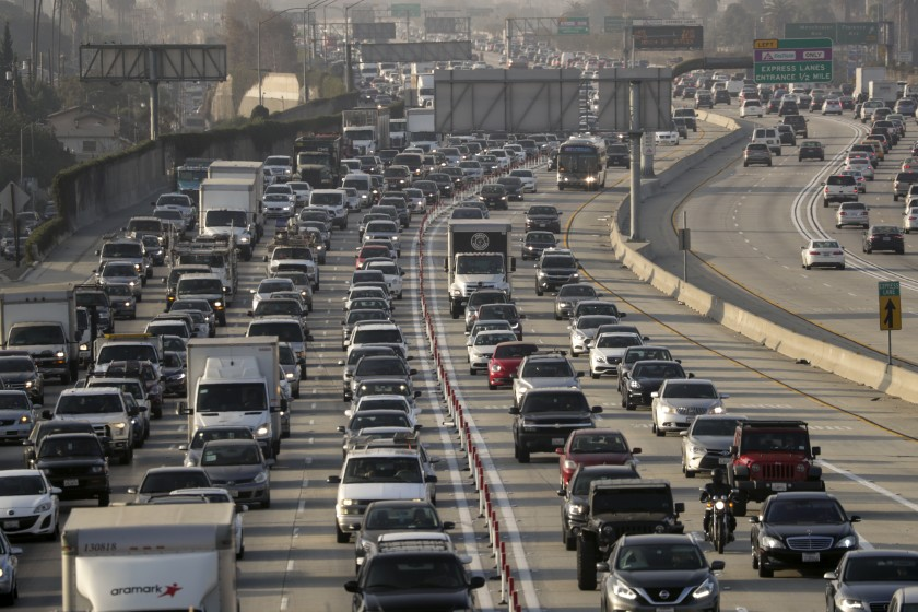 A rule change would restore California's authority to set fuel efficiency and greenhouse gas emission standards for cars and SUVs, (Irfan Khan / Los Angeles Times)