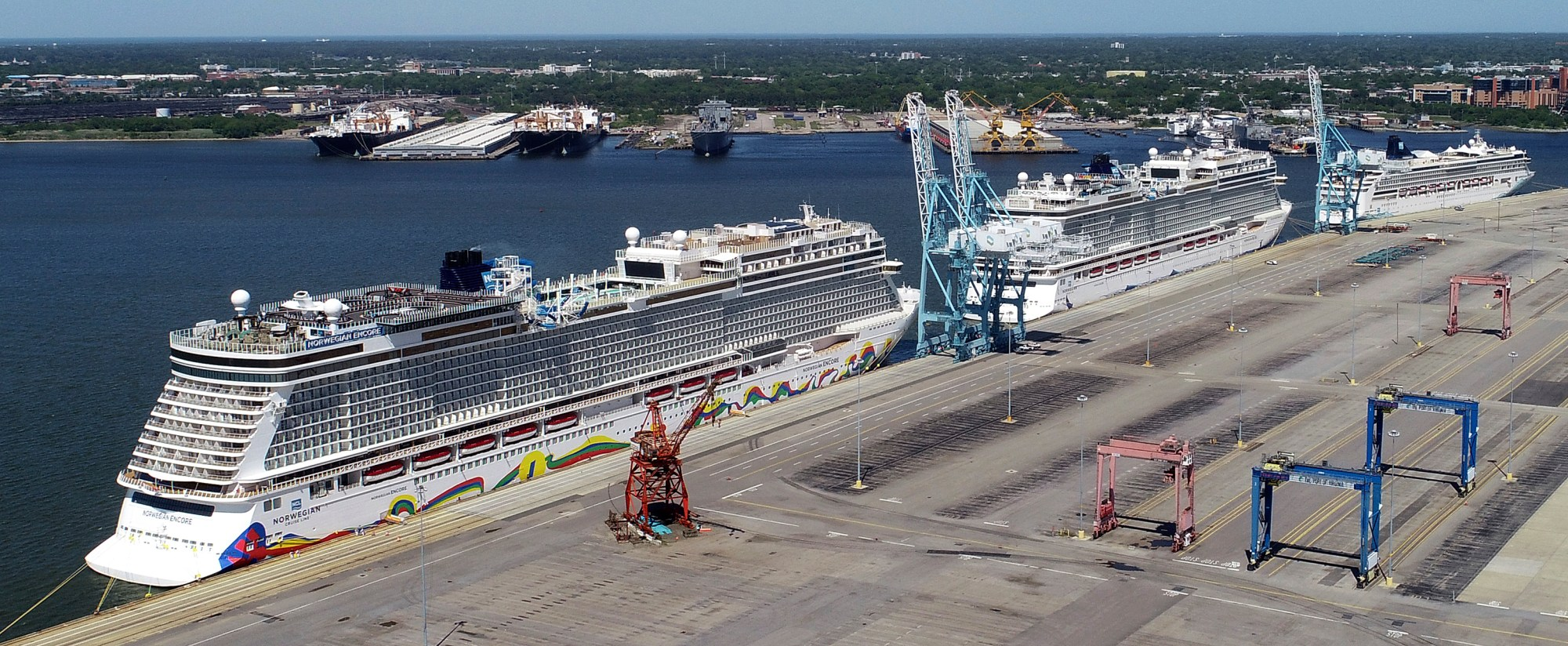 In this May 4, 2020 file photo, Norwegian cruise ships are docked at Portsmouth Marine Terminal in Portsmouth, Va. Norwegian Cruise Lines is threatening to skip Florida ports because of the governor's order banning businesses from requiring that customers be vaccinated against COVID-19. The company says Gov. Ron DeSantis' order conflicts with guidelines from federal health authorities that would let cruise ships sail in U.S. waters if passengers and crew members are vaccinated. (Stephen M. Katz/The Virginian-Pilot via AP, File)