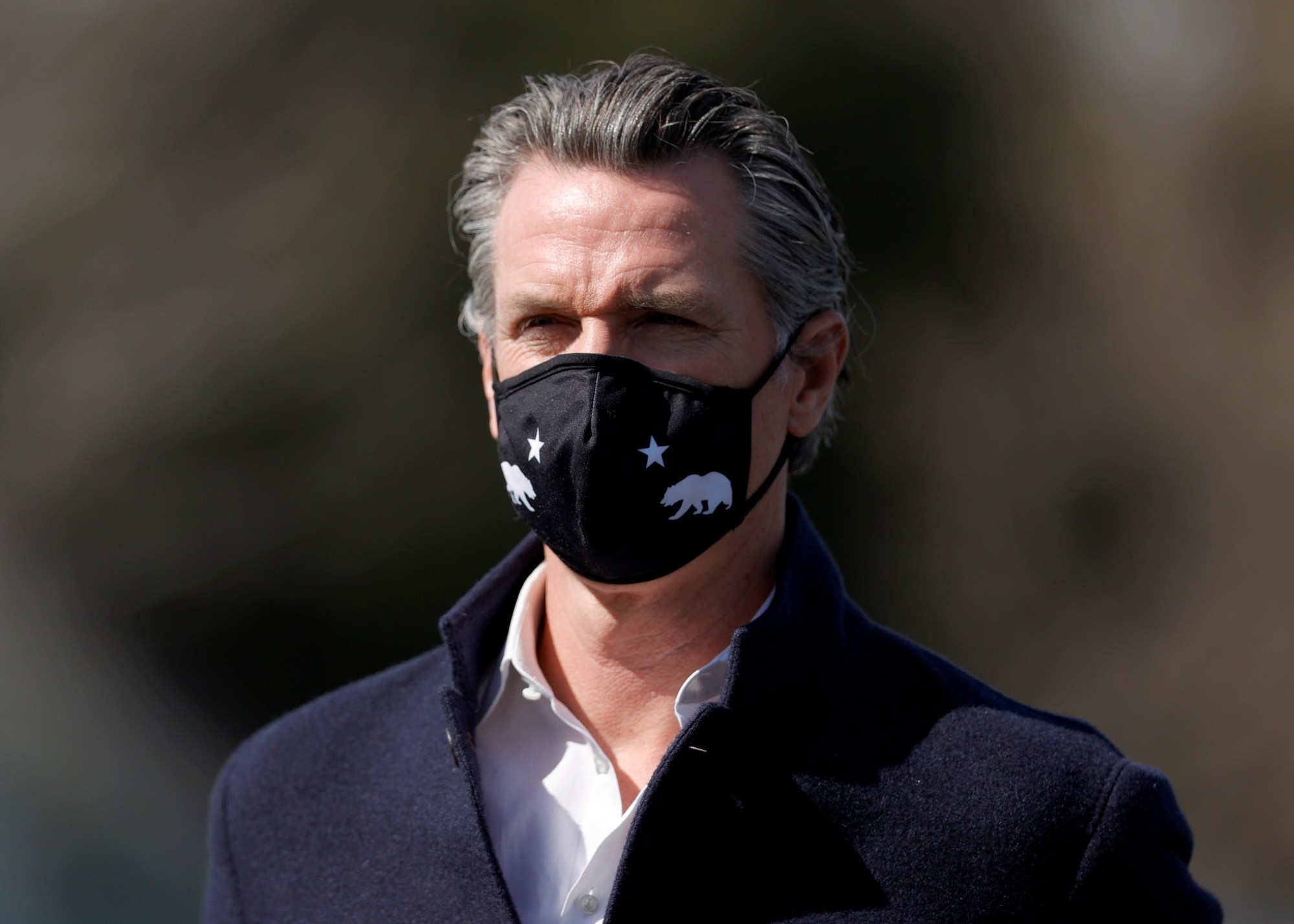 California Gov. Gavin Newsom looks on during a news conference after touring Barron Park Elementary School on March 02, 2021 in Palo Alto. (Justin Sullivan/Getty Images)