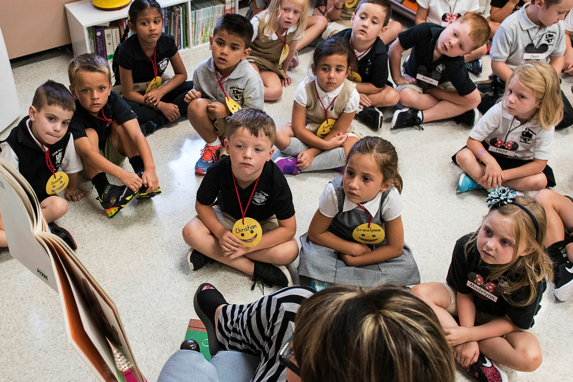 In this Aug. 22, 2018, file photo, students from two kindergarten classes at the Lewiston elementary campus of Saint Dominic Academy, listen to a teacher read a book, in Lewiston, Maine. (Russ Dillingham/Sun Journal via AP, File)