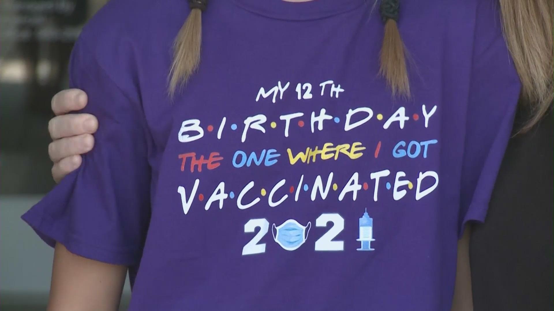 Sydney Hoag of Irvine celebrated turning 12 on July 23, 2021, by receiving her COVID-19 vaccine in Irvine. (KTLA)