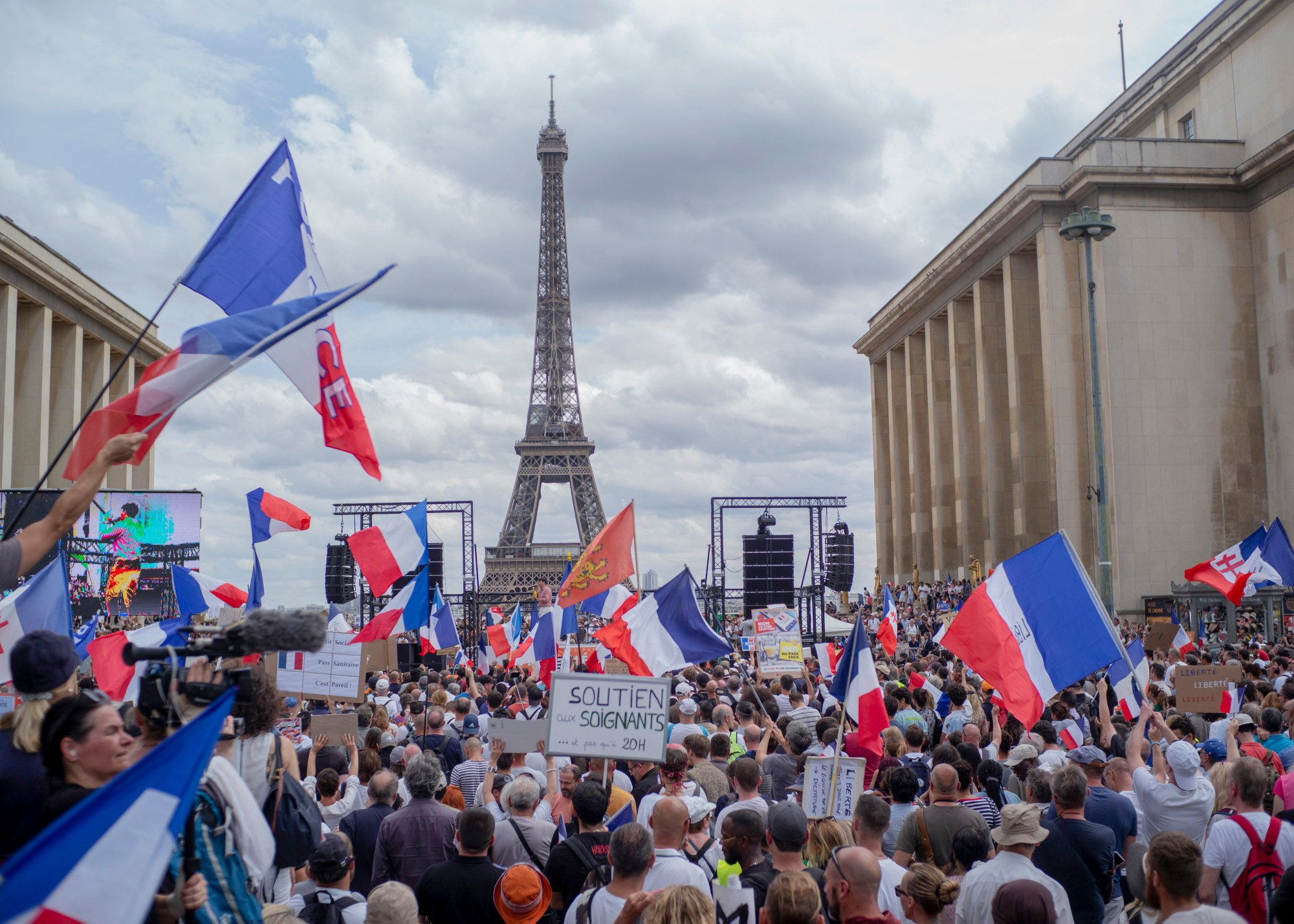 Thousands of protesters gather at Place Trocadero near the Eiffel Tower attend a demonstration in Paris, France, July 24, 2021, against the COVID-19 pass which grants vaccinated individuals greater ease of access to venues. (AP Photo/Rafael Yaghobzadeh)