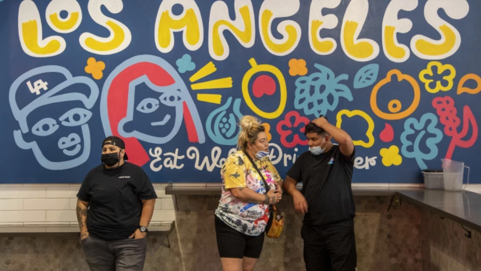 Visitors to the Grand Central Market in Los Angeles are both masked and unmasked on July 27. With coronavirus infections on the rise, officials are considering new measures to cap the spike.(Brian van der Brug / Los Angeles Times)