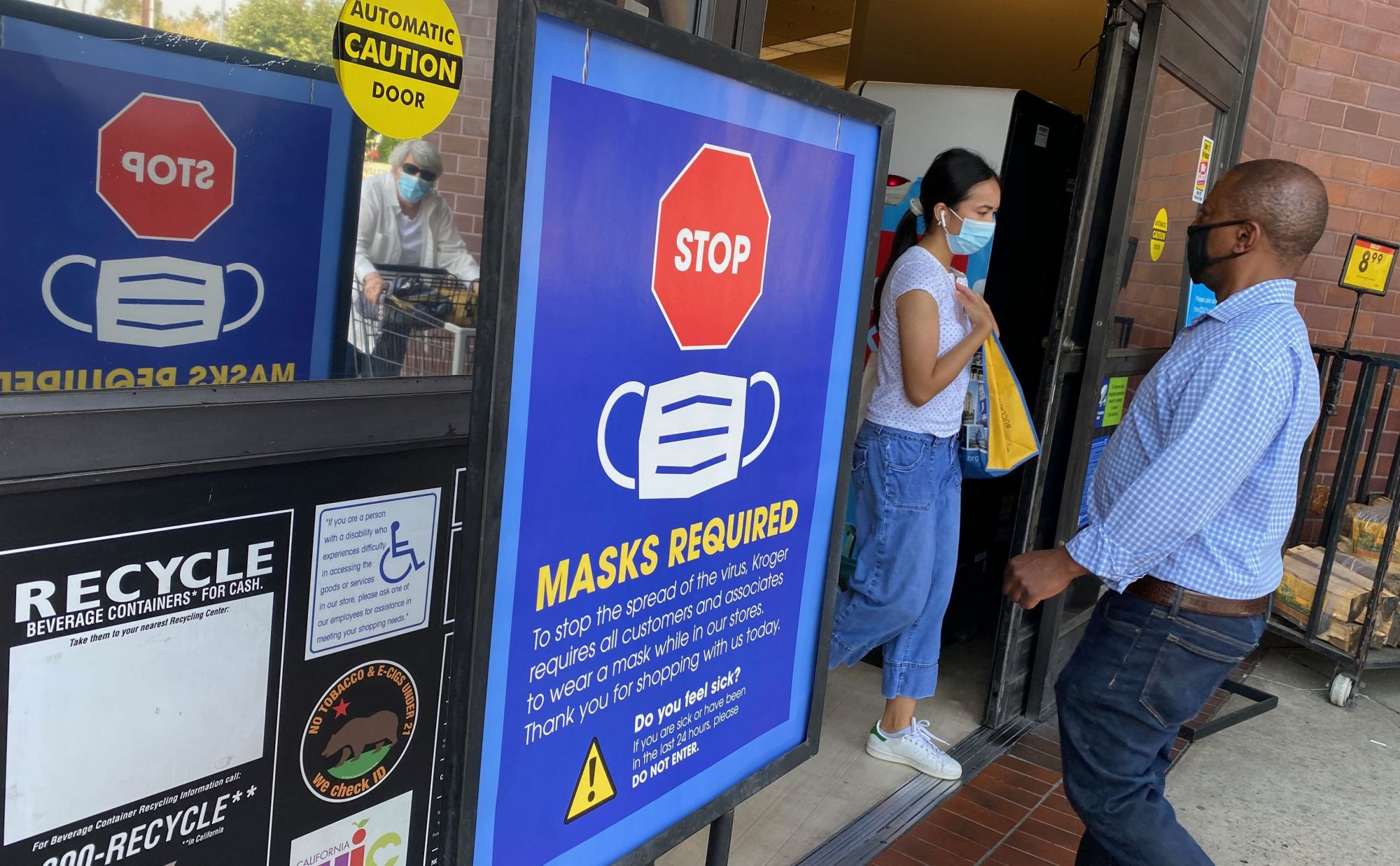 People shop at a grocery store enforcing the wearing of masks in Los Angeles on July 23, 2021. (Chris Delmas / AFP / Getty Images)