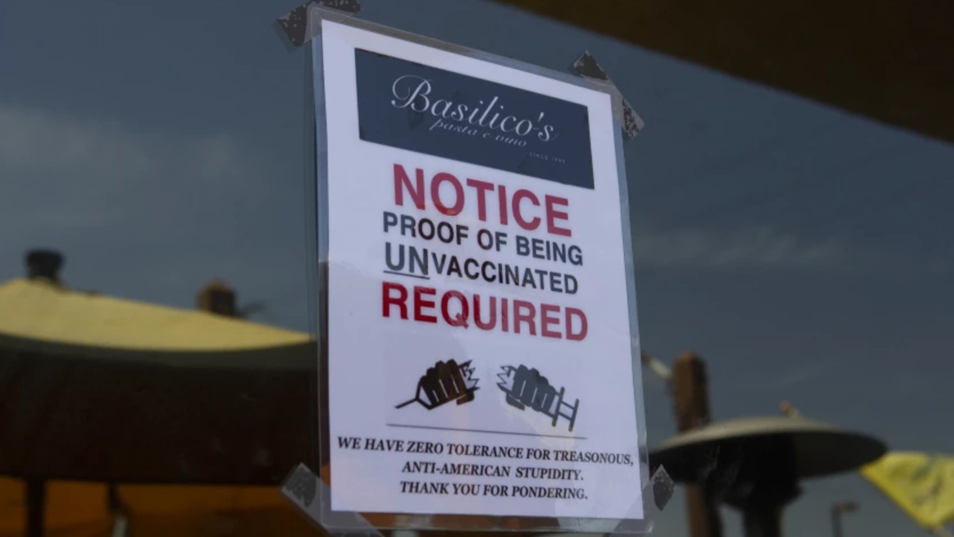 A sign outside Basilico's restaurant in Huntington Beach says patrons must be unvaccinated to enter.(Madeleine Hordinski / Los Angeles Times)