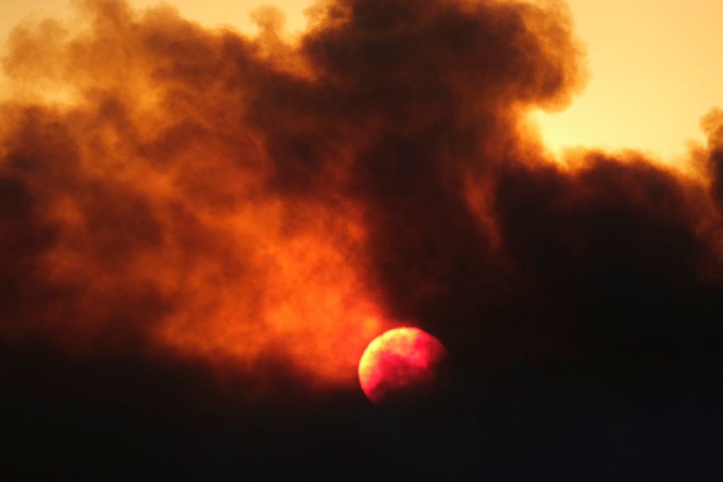 Smoke rises from a wildfire during the sunset Wednesday, Oct. 13, 2021, in Goleta, Calif. (AP Photo/Ringo H.W. Chiu)