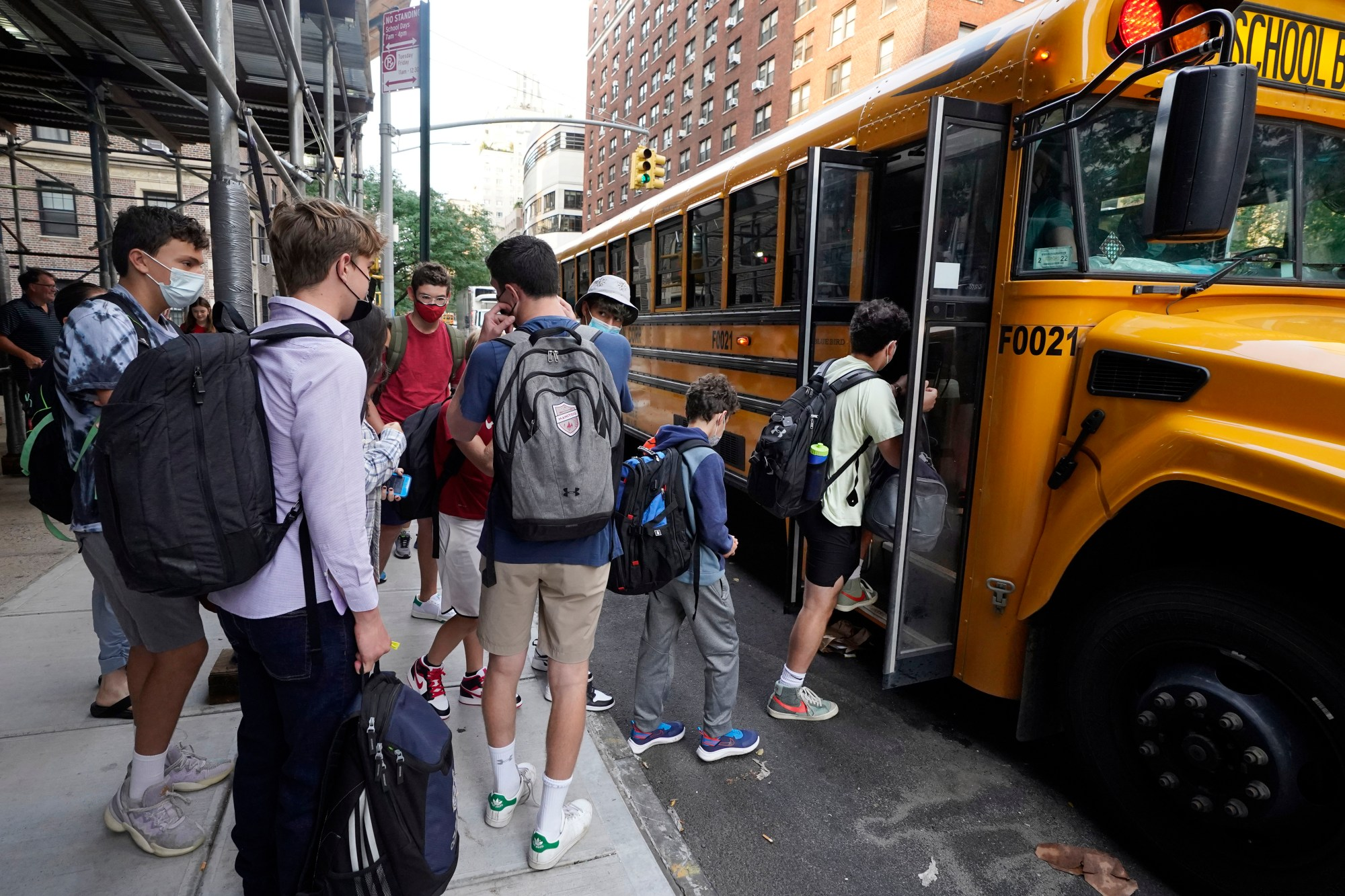 In this Sept. 13, 2021, file photo, students board a school bus on New York's Upper West Side. (AP Photo/Richard Drew, File)