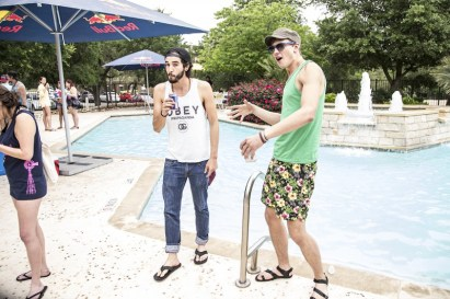 Two guys at Dakota Ranch's MR Fest Pool Party, one clearly didn't get the memo.