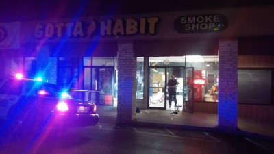 Police respond to a shooting that occurred outside the San Marcos-based Gotta Habit Smoke Shop. Photo by Reynaldo Leanos.