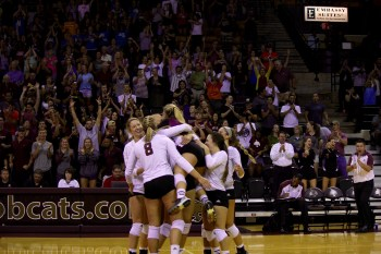The Bobcats celebrate a game-ending point. Photo by Alex Gifford.