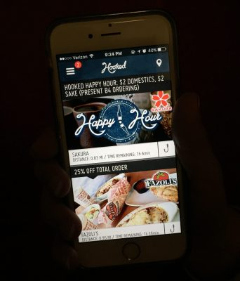 Apps like Hooked and RetailMeNot will save you a little money not and a lot of money in the long run. Photo by Allison Johnson.