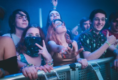 A group of friends feel the music during Liquid Stranger's set on December 29, 2017.