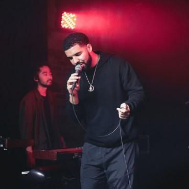 Drake singing into the mic