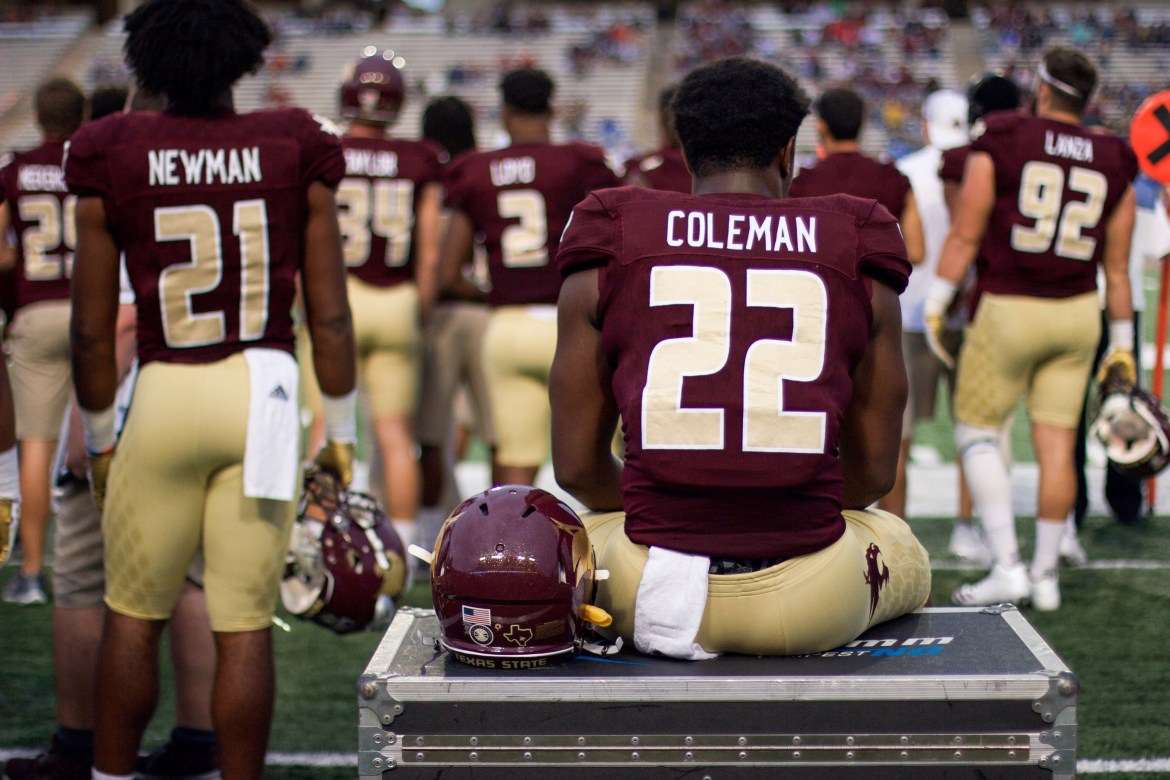 During the 33-30, 2017 loss to Georgia State, Markeveon Coleman, number 22, and Josh Newman, number 21, sit and stand, quietly watching the unfolding plays with somber posture.