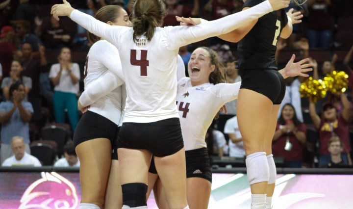 The Bobcats celebrate a point earned early in the match